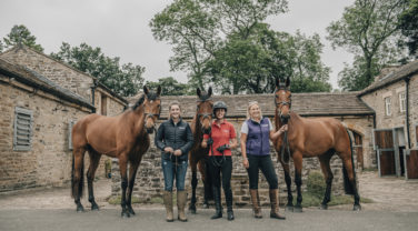 Dengie staff posing with Horses